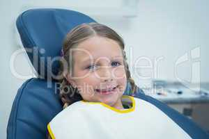 Smiling girl waiting for dental exam