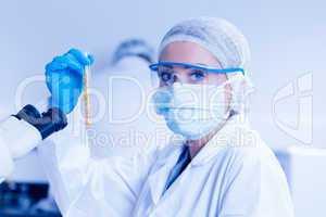 Food scientist holding test tube of corn