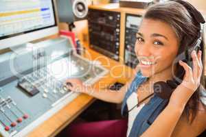 Smiling university student mixing audio