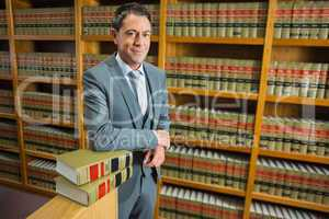 Lawyer standing in the law library