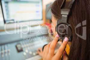 University student mixing audio in a studio