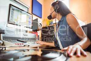Portrait of an university student mixing audio