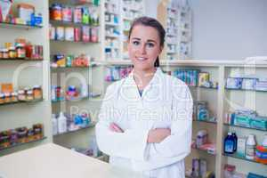 Portrait of a smiling student in lab coat looking at camera