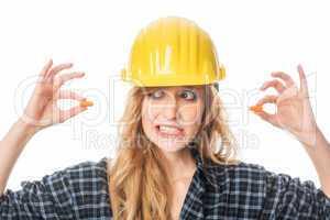 Handwerker mit Ohrenproppen
