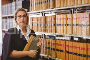 Serious lawyer holding a book