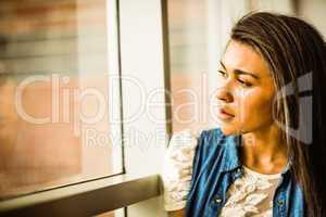 Pretty brunette sitting alone unsmiling
