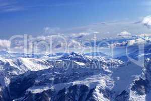 Sunlight snowy mountains