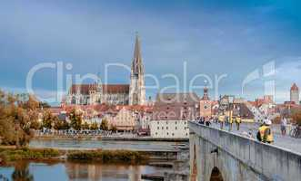REGENSBURG, GERMANY - JULY 12, 2012: Tourists enjoy city streets