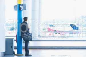 Indian businessman waiting bus