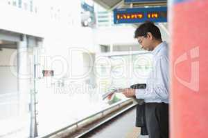 Indian business man waiting train