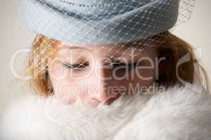 Close-up of redhead in blue veiled hat