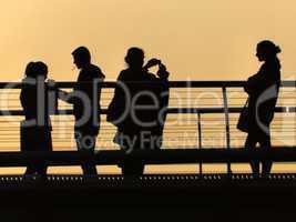 Millennium Bridge tourists at sunset