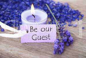 Purple Label With Text Be Our Guest And Lavender Blossoms