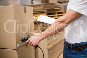 Worker using scanner in warehouse