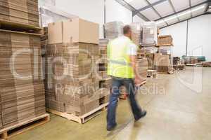 Blurred worker walking in warehouse