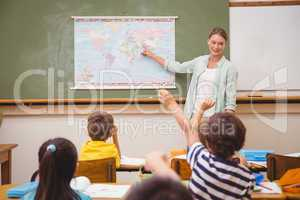 Teacher giving a geography lesson in classroom
