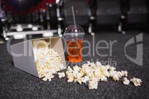 Falling box of pop corn and drink