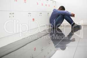 Solitary university student sitting on the floor