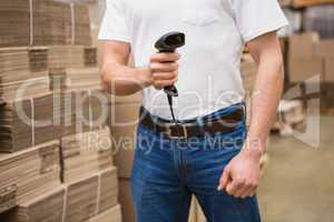 Close up of warehouse worker holding scanner