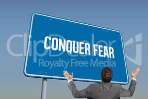 Conquer fear against blue sky