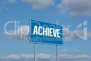 Achieve sign against sky