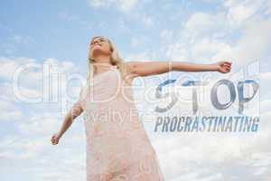 Composite image of young woman in summer dress stretching arms a
