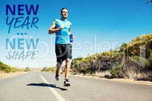 Composite image of athletic man jogging on open road holding bot