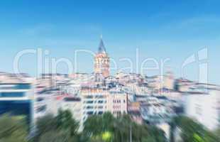 Blurred zoomed view of Galata tower and quarter in Istanbul