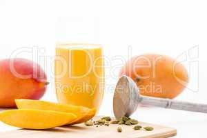 Mango Flesh, Cardamom, Pestle And Mango Mocktail