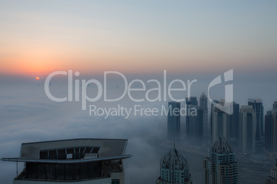 view foggy weather Dubai Marina at sunrise