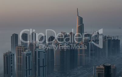 aerial view skyscraper foggy weather Dubai Marina at morning