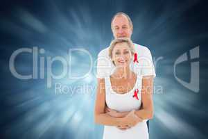 Composite image of mature couple supporting aids awareness toget