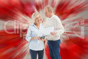Composite image of mature couple working out their bills