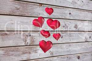Composite image of floating love hearts