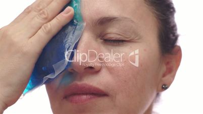 Woman With Cold Pack For Migraine
