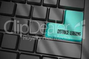 Distance learning on black keyboard with blue key