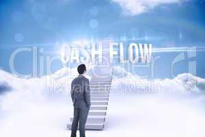 Cash flow against shut door at top of stairs in the sky