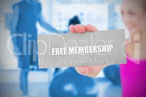 Fit blonde holding card saying free membership
