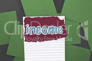 Income against green paper strewn over black