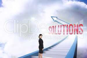 Solutions against red staircase arrow pointing up against sky