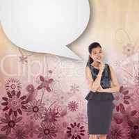 Composite image of thoughtful asian businesswoman with speech bu