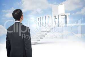 Budget against steps leading to open door in the sky