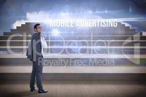 Mobile advertising against steps against blue sky