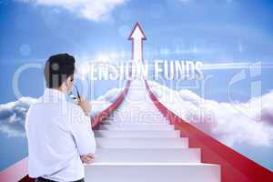 Pension funds against red steps arrow pointing up against sky