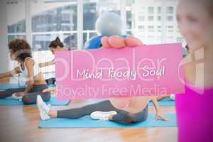 Fit blonde holding card saying mind body soul