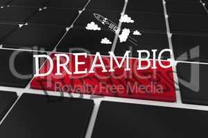 Dream big against black keyboard with red key