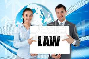Business partners holding card saying law