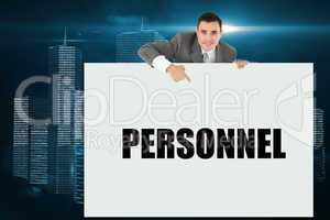 Businessman showing card saying personnel