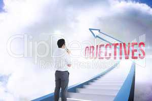 Objectives against red staircase arrow pointing up against sky
