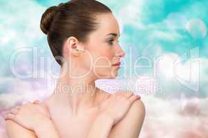 Composite image of beautiful brunette with arms over chest